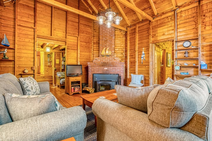 River view home w/ lovely deck, views & fireplace!