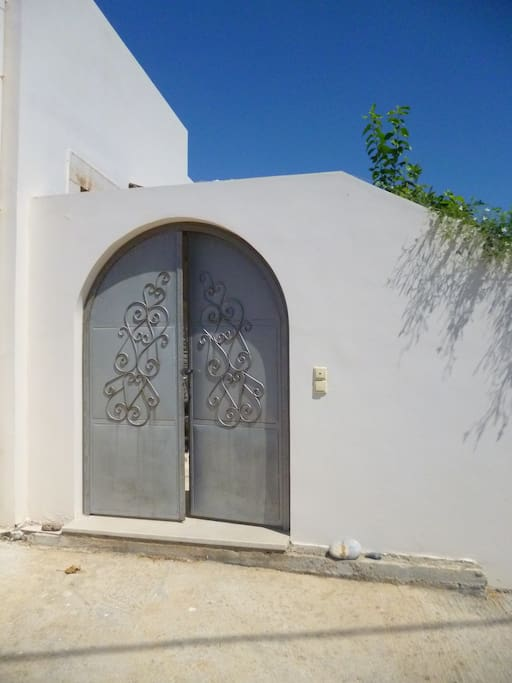 The main gate that leads to the courtyard and the house, designed by hand!