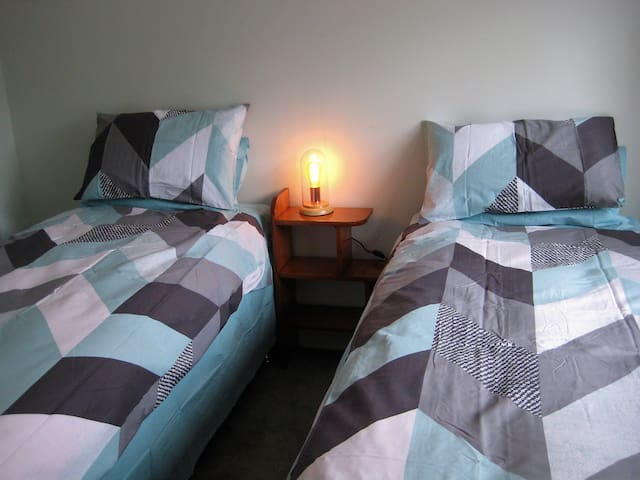 Second bedroom with a King size bed that can be converted into two single beds.