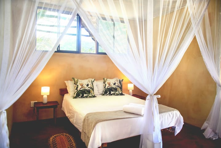 Double bed & large walk-in mosquito net