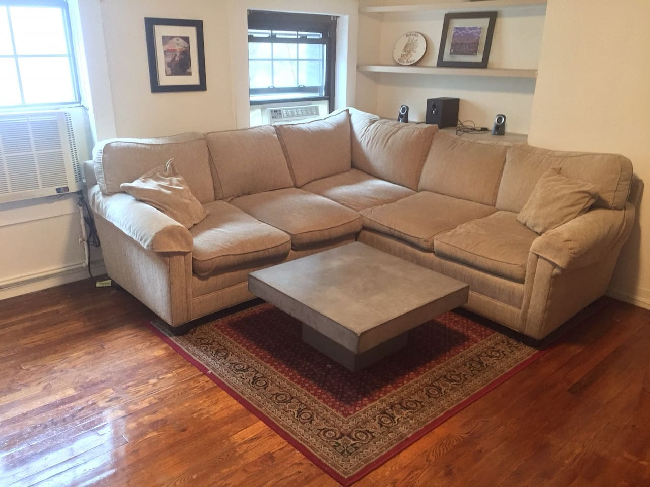 Large sectional couch in spacious living room