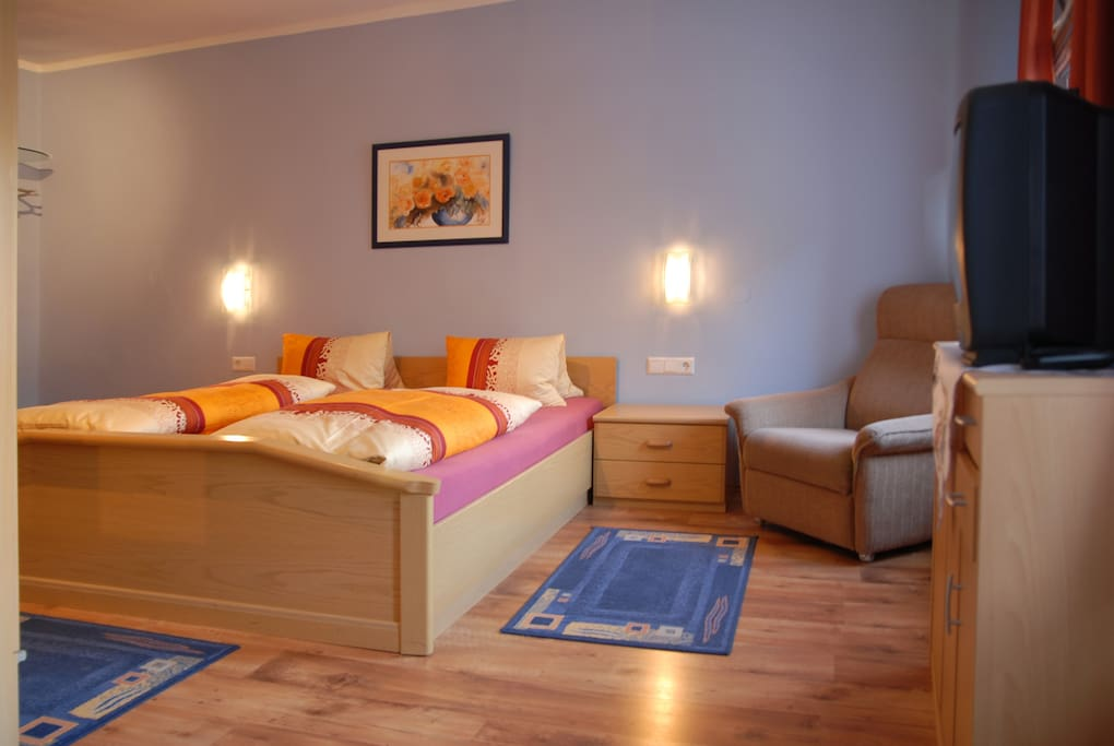 Spacious bedroom sleeps 4, king size bed and alcove with double bed.