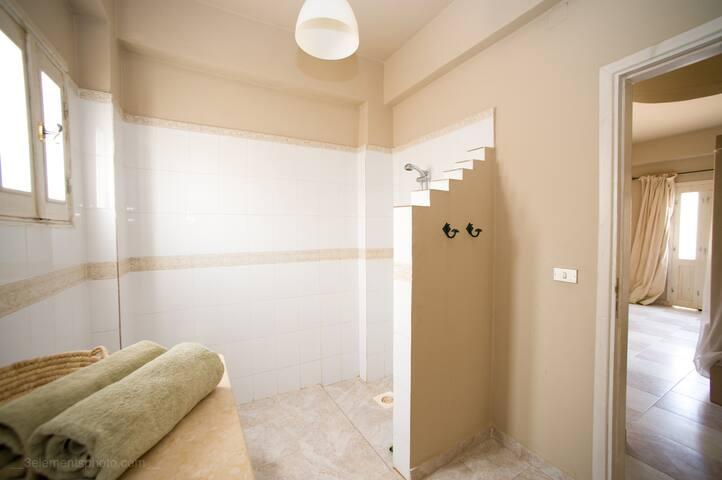 The master bedroom has a luxury ensuite bathroom