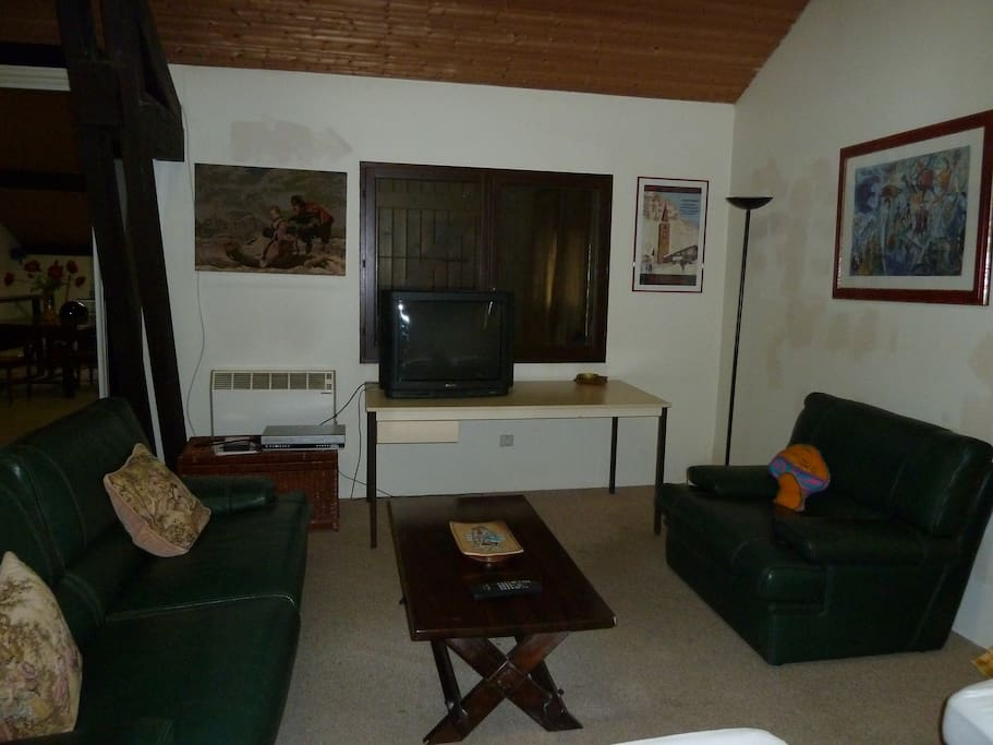 Living room with large screen DVD player.
