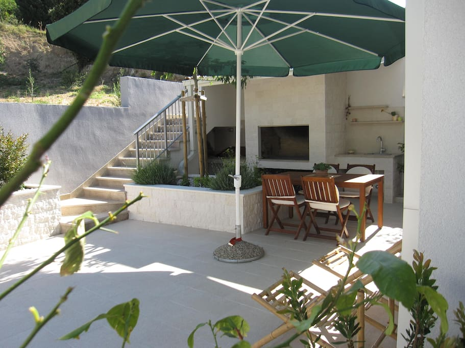 Terrace - part with summer kitchenette - table, barbecue and water sink