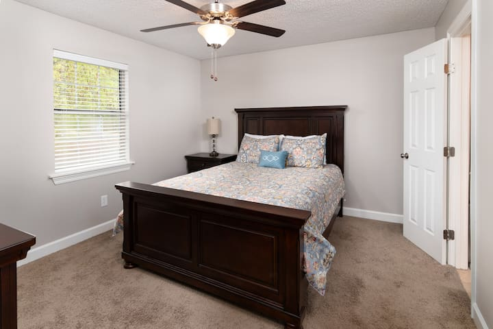 Spacious bedroom with a Queen size bed and flat screen TV.  Each bedroom has it's own private bathroom and walk-in closet.