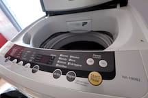 Washing machine is located in the kitchen, quite big to wash many clothes at a time...