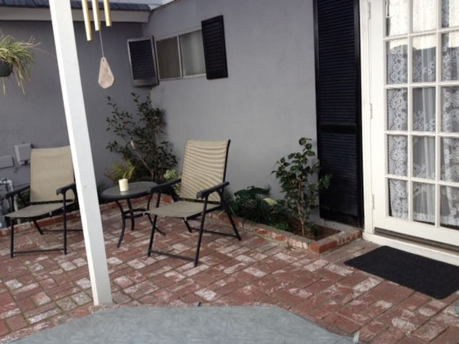 Enjoy a beverage or snack on your private patio with spa