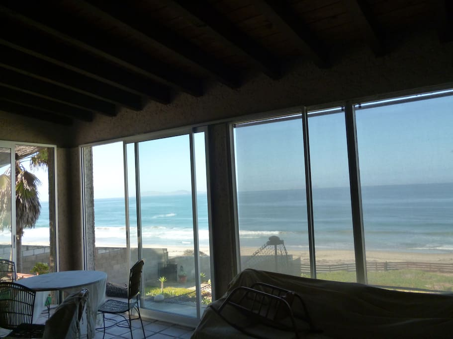 View of the ocean from the living room inside the house