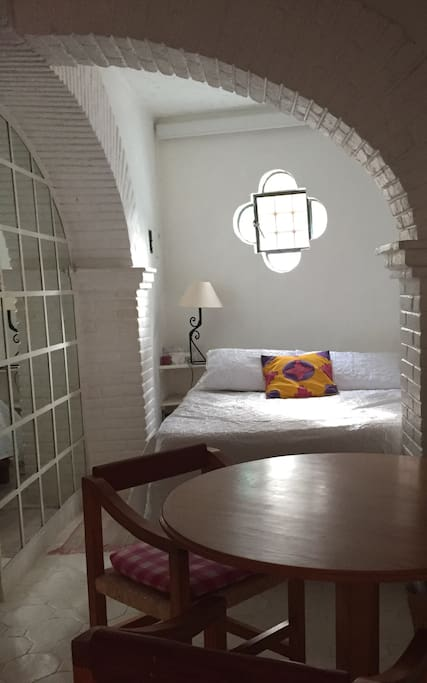 View of bedroom area with full size bed.