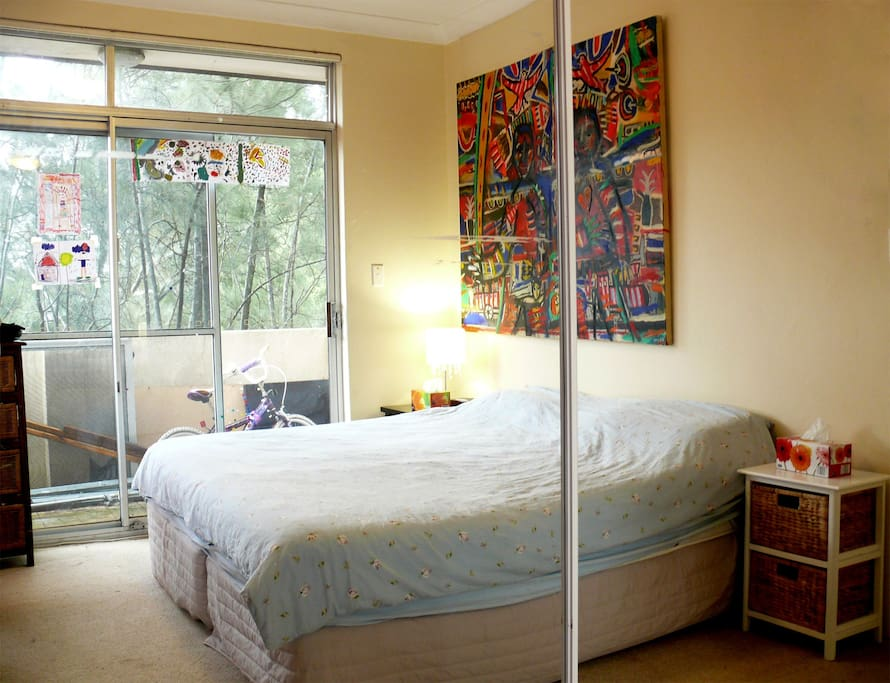 Master bedroom with leafy outlook off side balcony