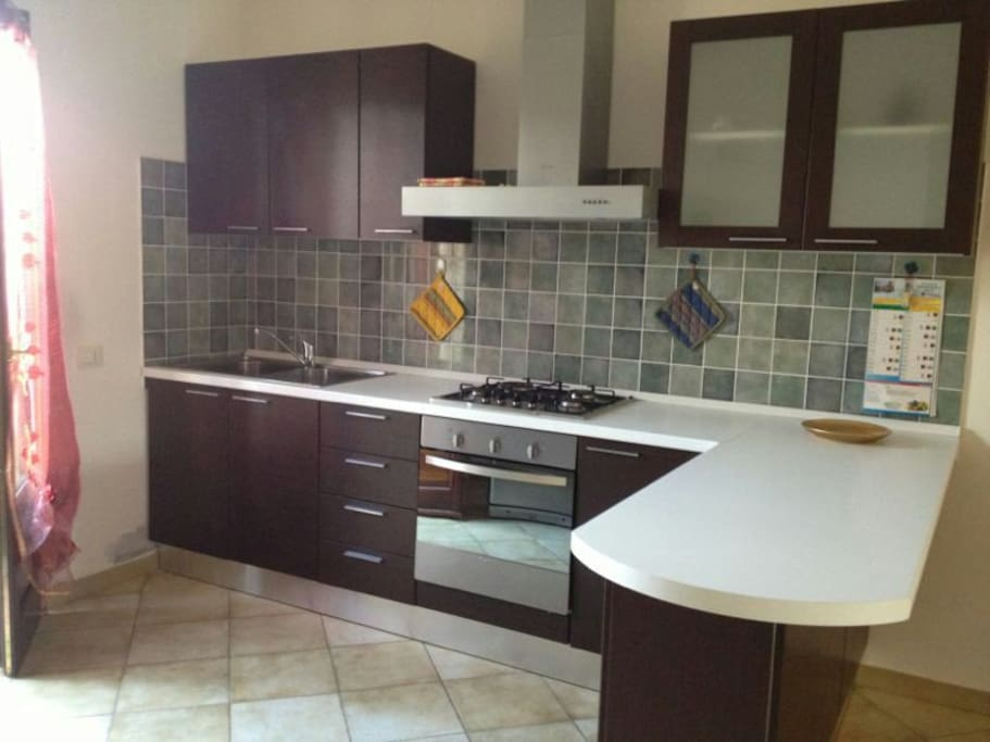 The kitchen, including oven, cooktop, big fridge with freezer, washing machine, waterboiler, coffeemaker