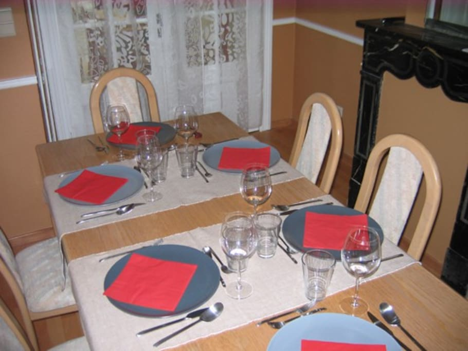 Dining table has complete servce for 4 or 6 (shown) or even 8.