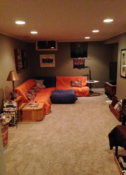 Large modern sectional that seats 6 -8 with extra floor space for additional guests with flat screen TV