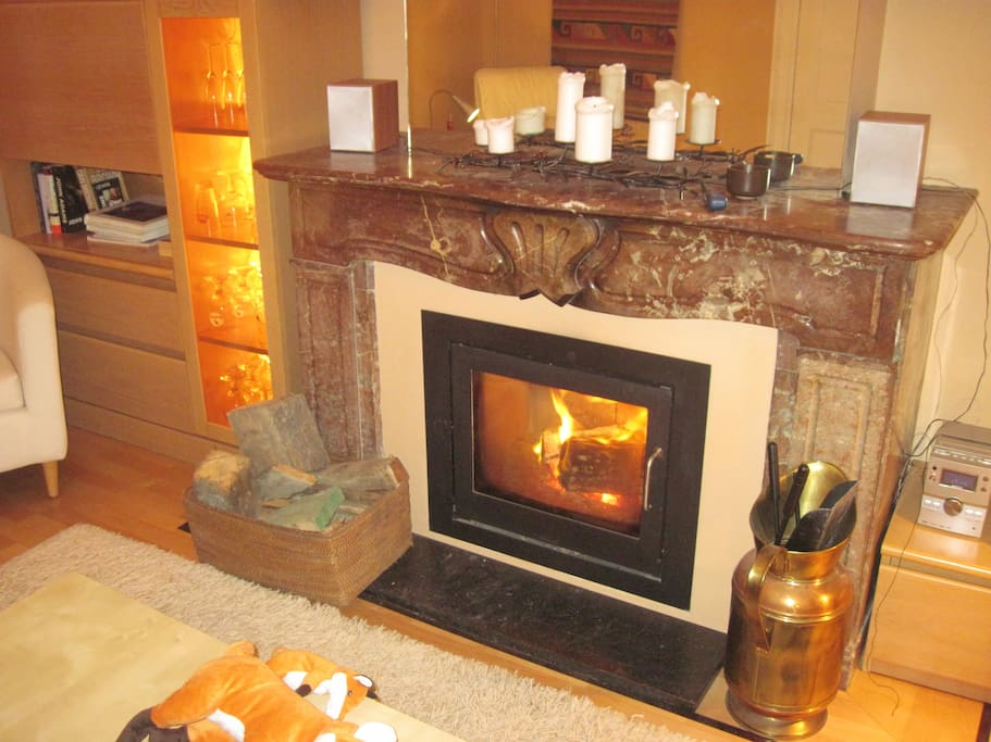 Real  fireplace makes the living room cozy for relaxing and entertaining.