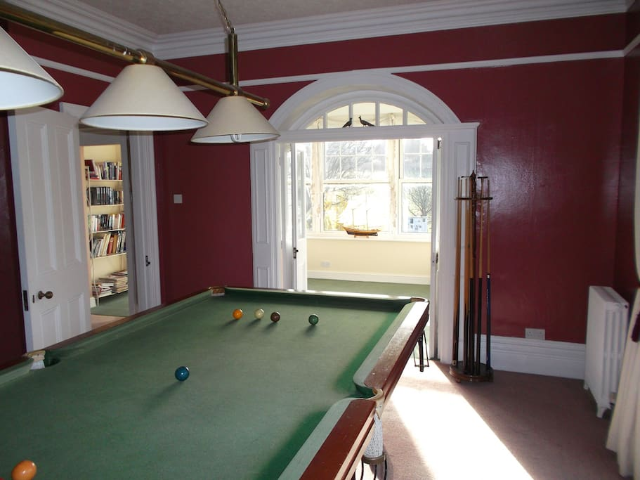 The snooker dining room at Polruan where breakfast and evening meals are served.  Perfect for groups.