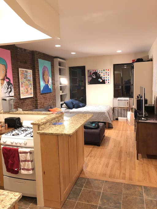 View of the studio showing the kitchen and living space