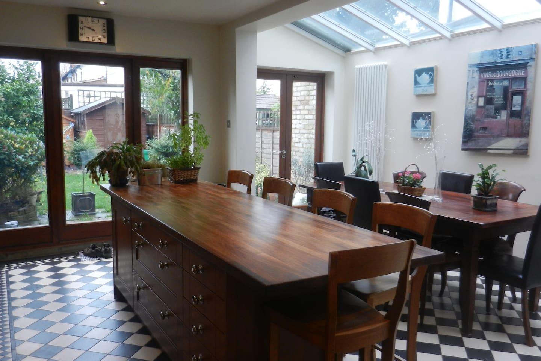 Huge bright dining/ kitchen space overlooking garden.