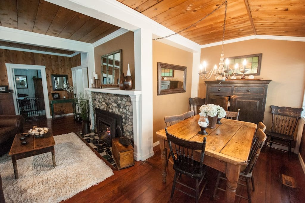 open plan living area, cozy fire place and dining area.