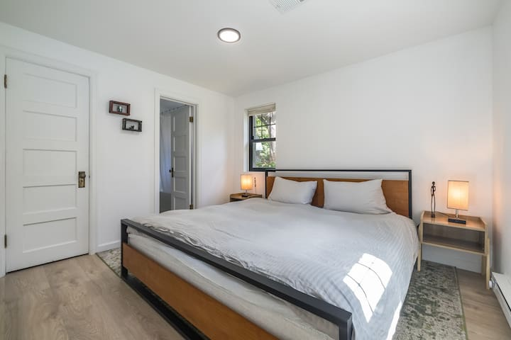 King size bed in a separate bedroom with bathroom access.