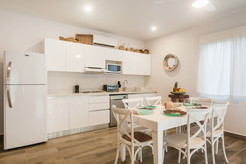 Dinning area with a fully equipped kitchen