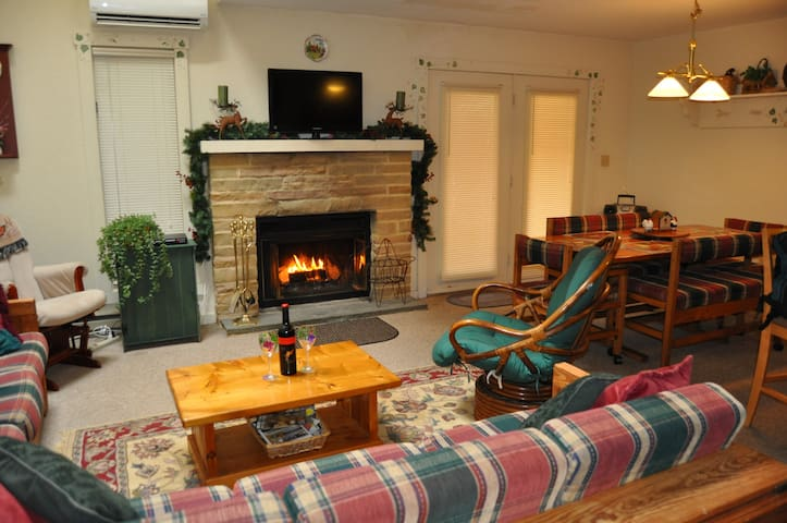 LR with wood burning fireplace and flatscreen tv