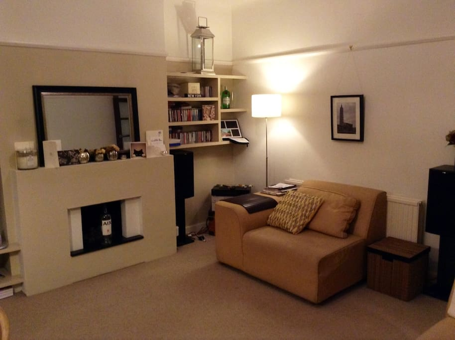 Large but cosy living room at night.