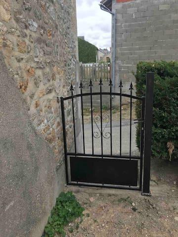 Jardin accessible par le portillon