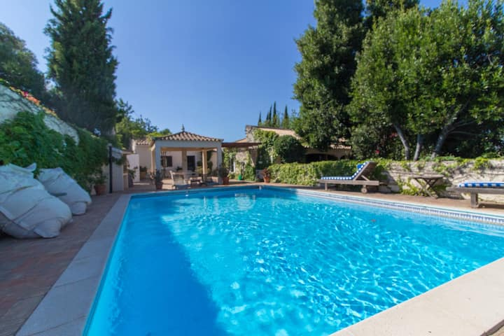 Own house on a 3 villas property with shared pool.