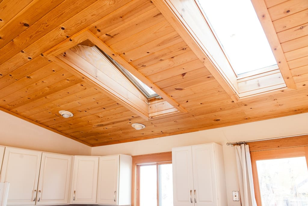 Beautiful, warm wood ceiling and two skylights