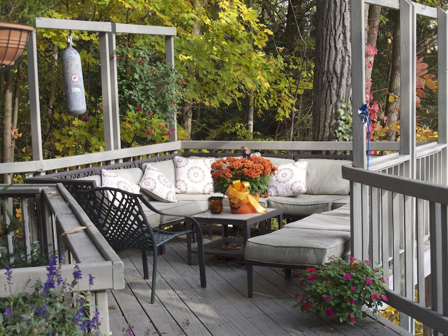 A cozy nook on the deck is perfect for reading, drinking coffee or wine, and relaxing while watching the lake