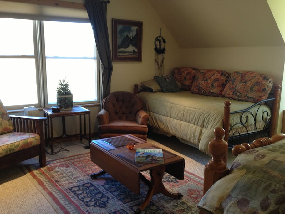 Sitting area & day bed in east guest room on the 3rd Floor.