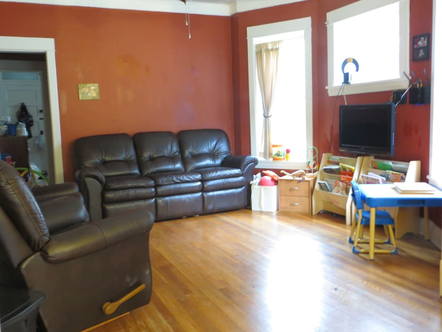 Second room: Living Room. Couch is VERY comfortable to sleep on, both ends also recline.