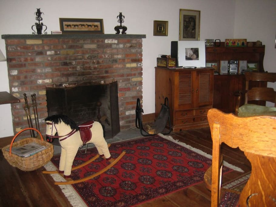 The rocking horse was the first inhabitant of this home when I purchased it about 10 years ago.  He trots from room to room and is no longer in this initial spot by the living room fireside.