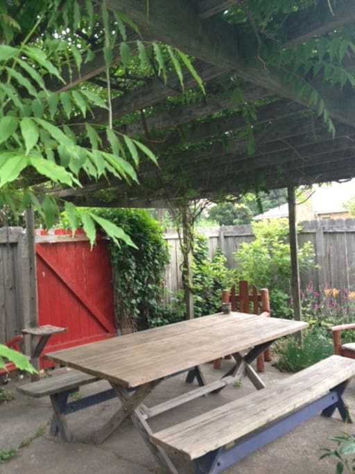 Over-sized picnic table to enjoy in private back yard, relax under the arbor covered in green vines dripping with Wisteria flowers. By far this is the best place for journaling and listening to morning birds.