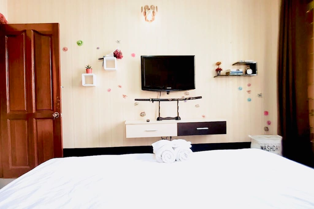 Bedroom with king size bed and flat TV