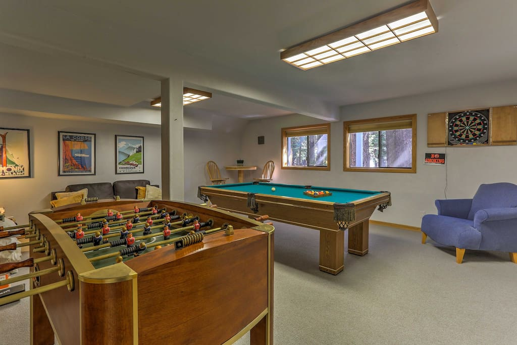 The spacious home boasts 2,750 square feet and features 5 decks, a comfortable interior, and a game room with a foosball table, pool table and darts.