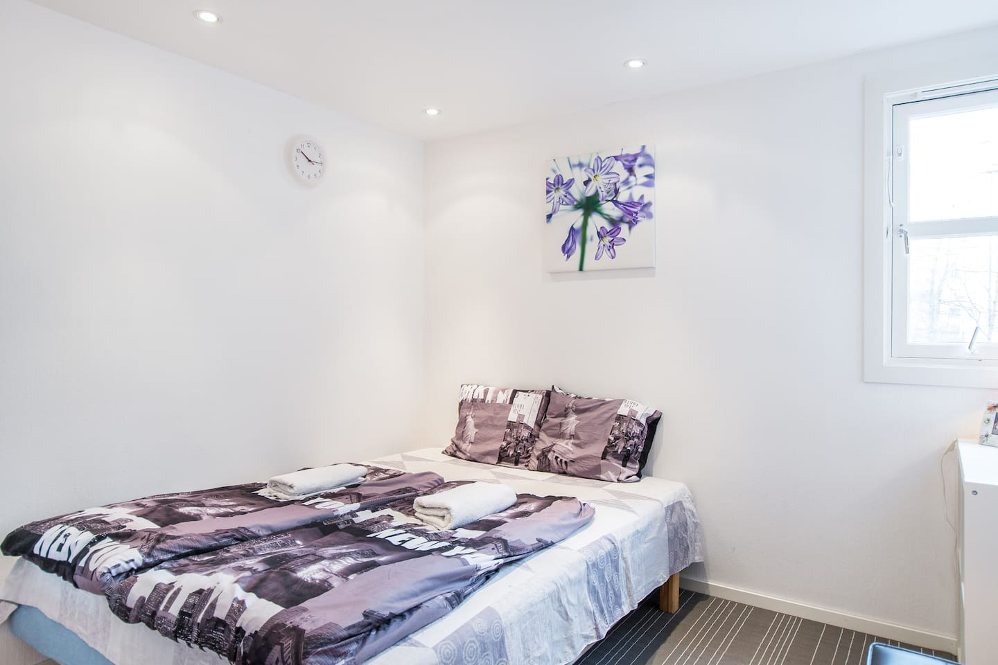 Spacious & cozy bedroom with windows and false ceiling