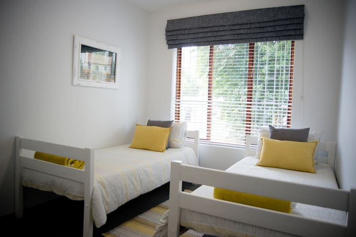 3rd bedroom 2 x 3/4 beds best suited for teenagers / children. Lockable door. Windows have blinds and Roman blind for extreme blackout and privacy. Full wifi available in entire unit. This room has USB charging points on the plug point