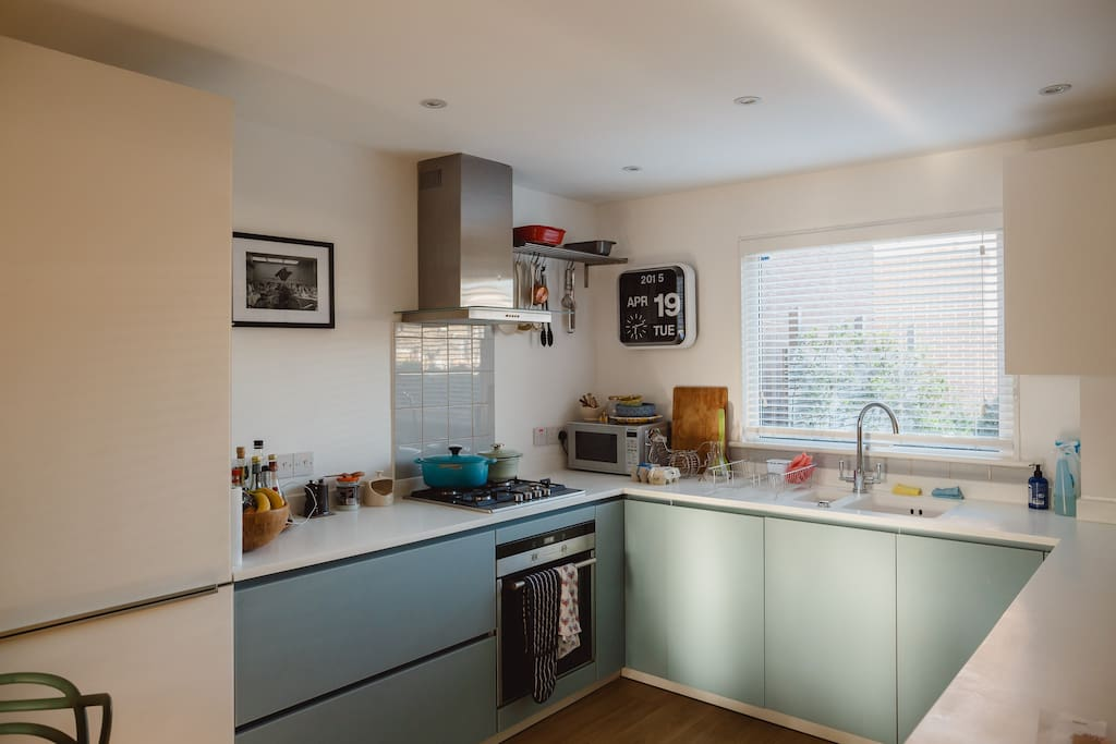 Kitchen with oven, hob, microwave, fridge