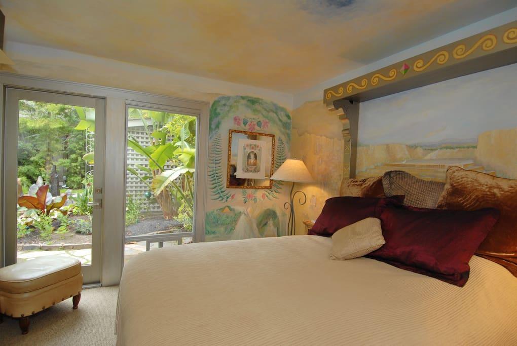 Queen Bed with garden view.