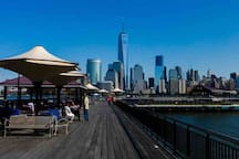 10 minute walk to the Exchange Place Boardwalk where you can pay a small fare and experience spectacular views of the Hudson Rover and lower Manhattan.