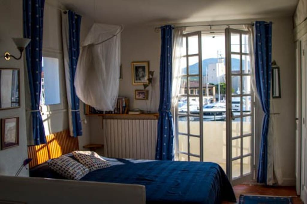 Top bedroom with double bed, sofa bed and doors to balcony
