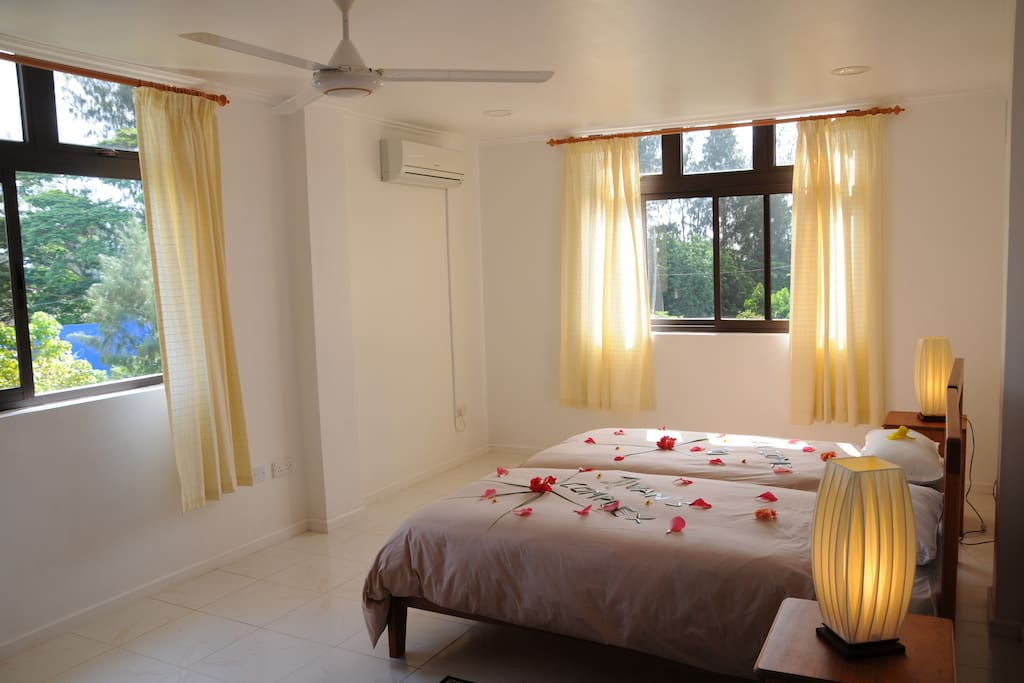 Comfortable, well lighted bedrooms with a view of the mountains behind.