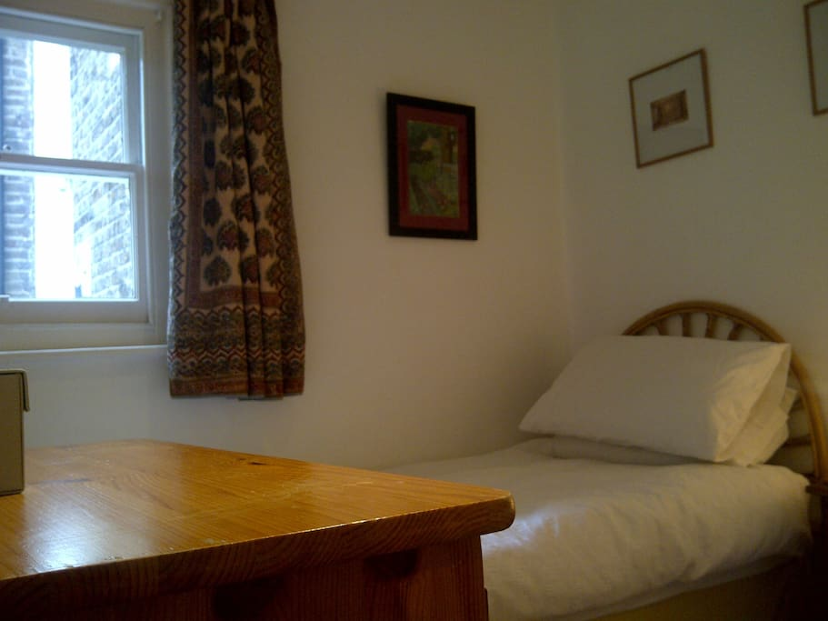 Single room with comfortable single bed with extra mattress topper for single occupancy only.