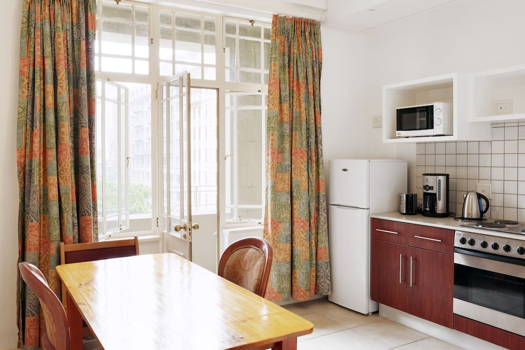 Fitted kitchen with all appliances including an oven