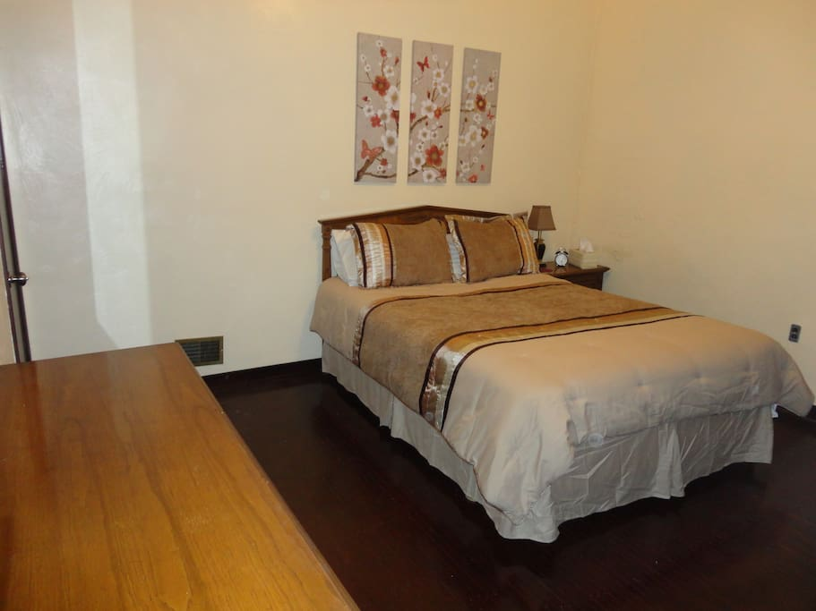 Bedroom 2 features a comfortable Queen size bed with pediment headboard,