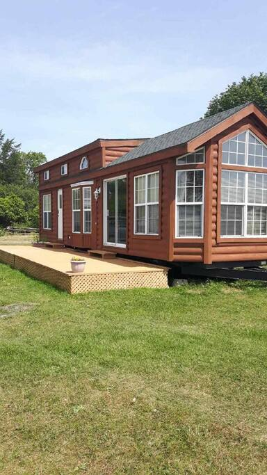 Exterior photo of the park model trailer home.