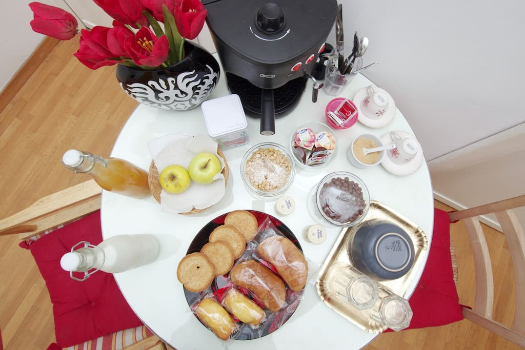 Breakfast is included exactely as you can see in the picture: milk, orange juice, jam, butter, crackers, croissants, coffee, tea, cereals and fruits
