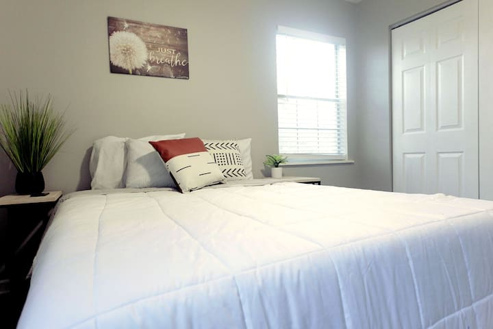 Our second bedroom features a comfortable queen bed
